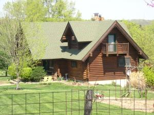 Log home across from the Post